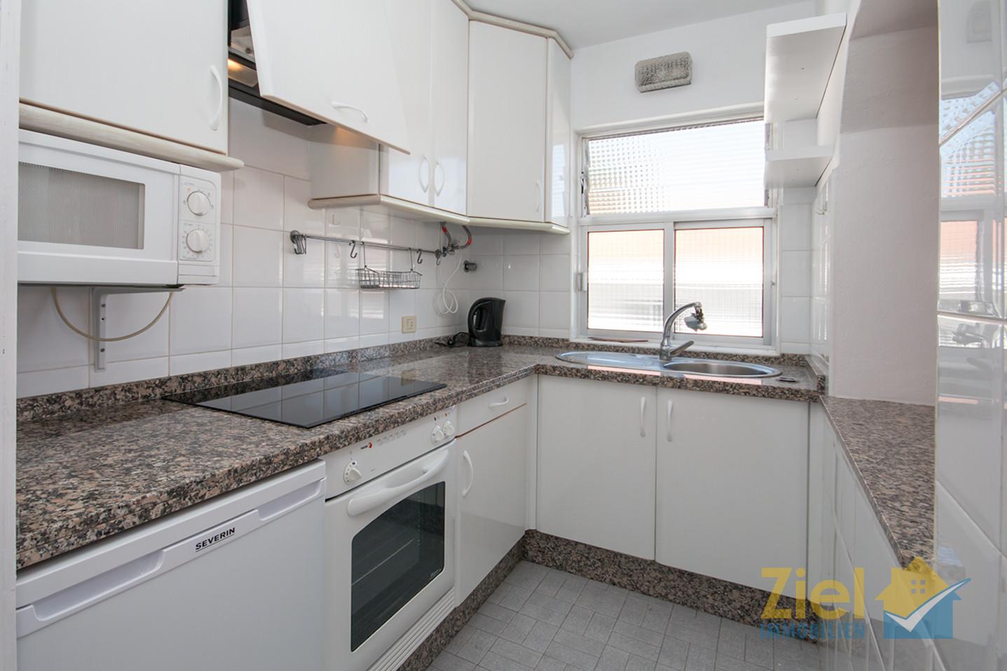 Voll ausgestattete Apartmentküche