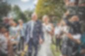 Bride and Groom in confetti by Lancashire based professional wedding photographer Jon Boriss