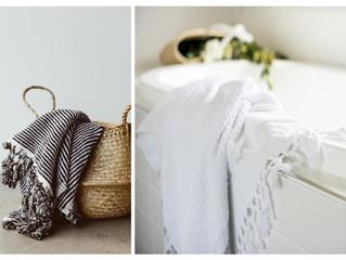 Milan black & white stripe and Sicily white Organic bath towels.