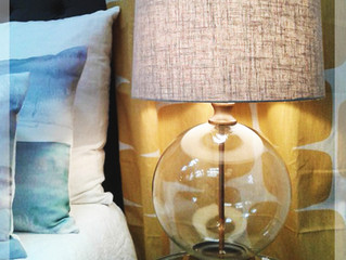 A beautiful glass based lamp that comes with a natural linen shade.