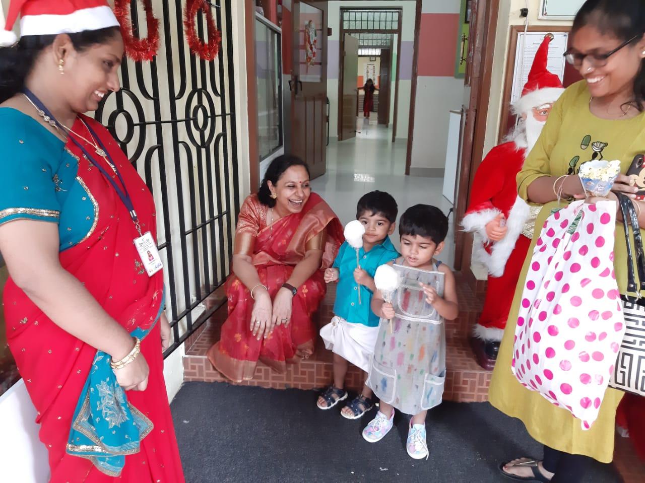 Enjoying cotton candy with Smita aunty