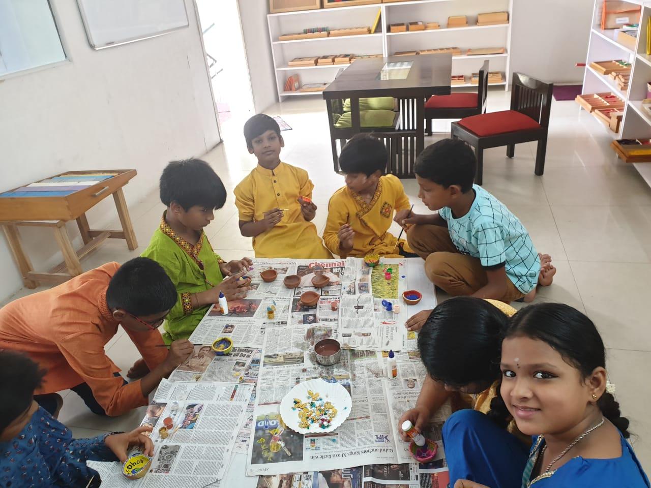 Diyas being painted