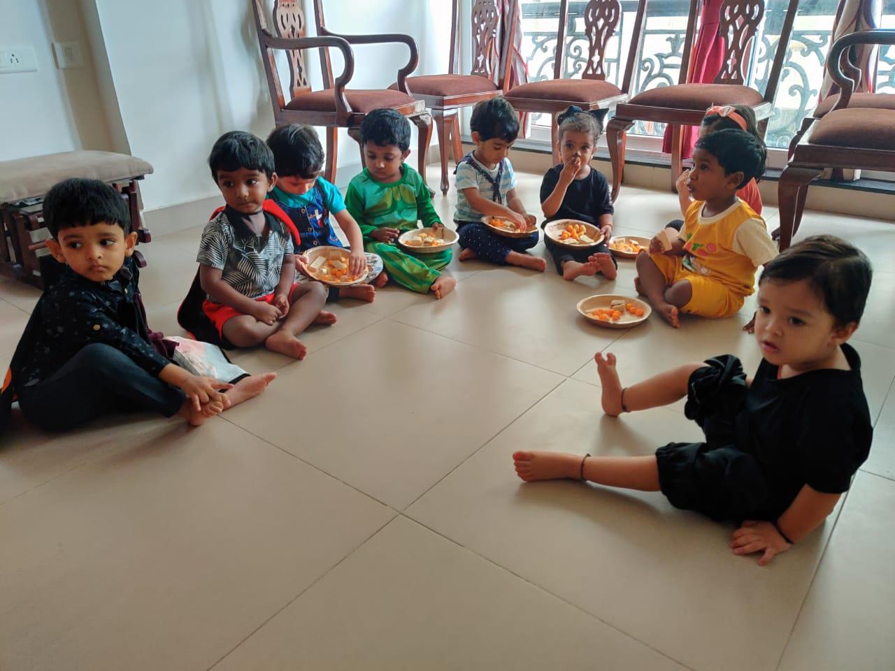 Relishing snacks during House Visit