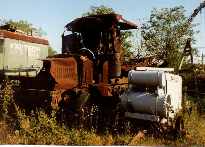 Part of an AC Mack crane & an air compressor