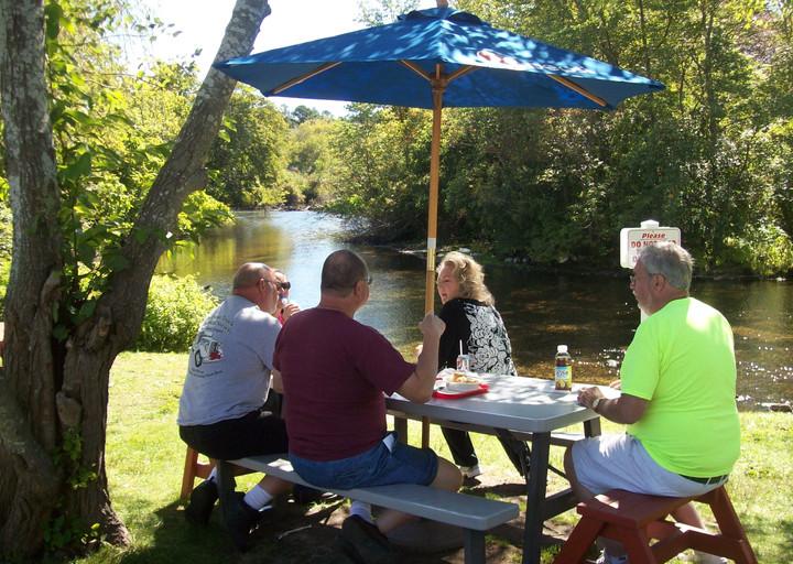 Members enjoying lunch along the Peconic river