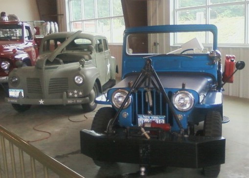 Jeep & military staff car inside museum
