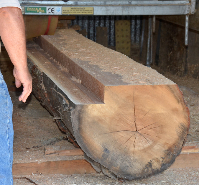 "Lucas swing blade mill cutting 2""x6"" boards from a 20' red oak log"