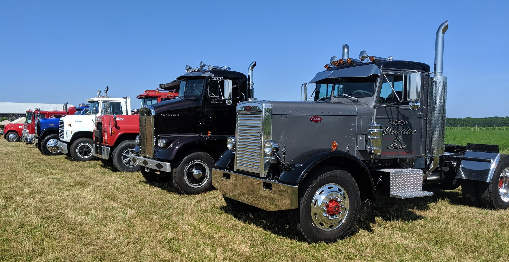 Line up of trucks on the show field