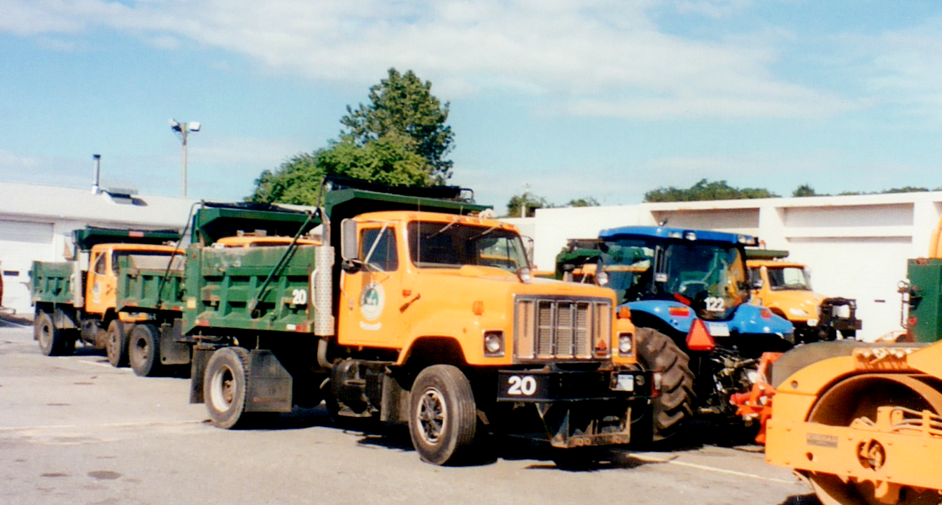 Older equipment parked in the yard.