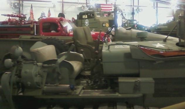 Vehicles on display inside museum