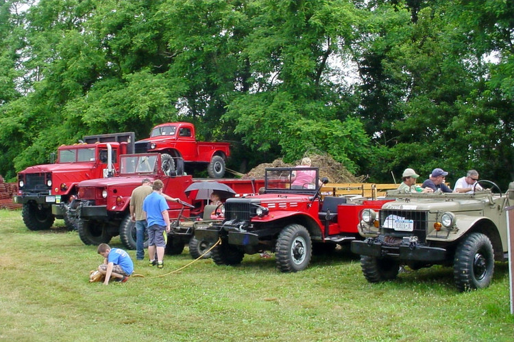Line up of former military vehicles