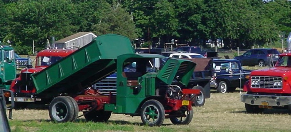 1925 AC Mack dump, 1949 Mack tractor & 1969 GMC flatbed on show field