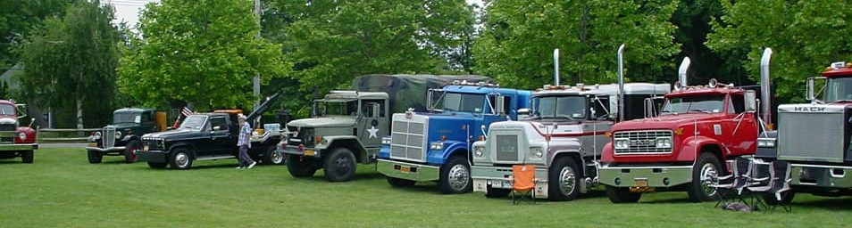 Line up of members & non-members antique trucks
