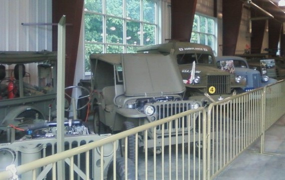 Jeeps and trucks  inside museum