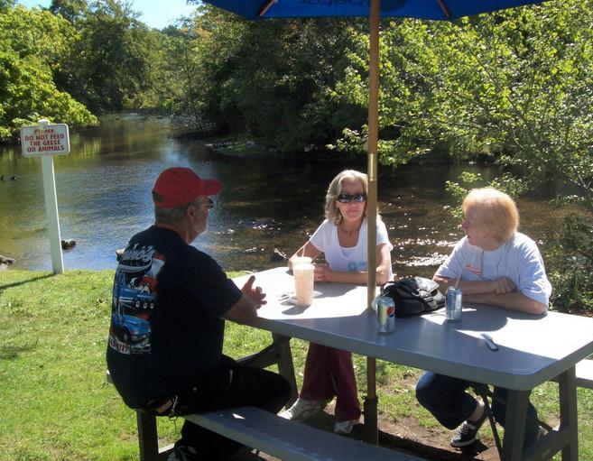Members enjoying an outdoor lunch
