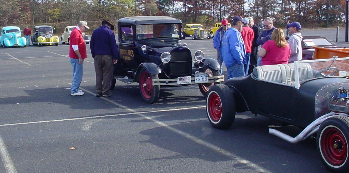 Spectators checking out John Prechtl's 1929 Ford Model A pickup