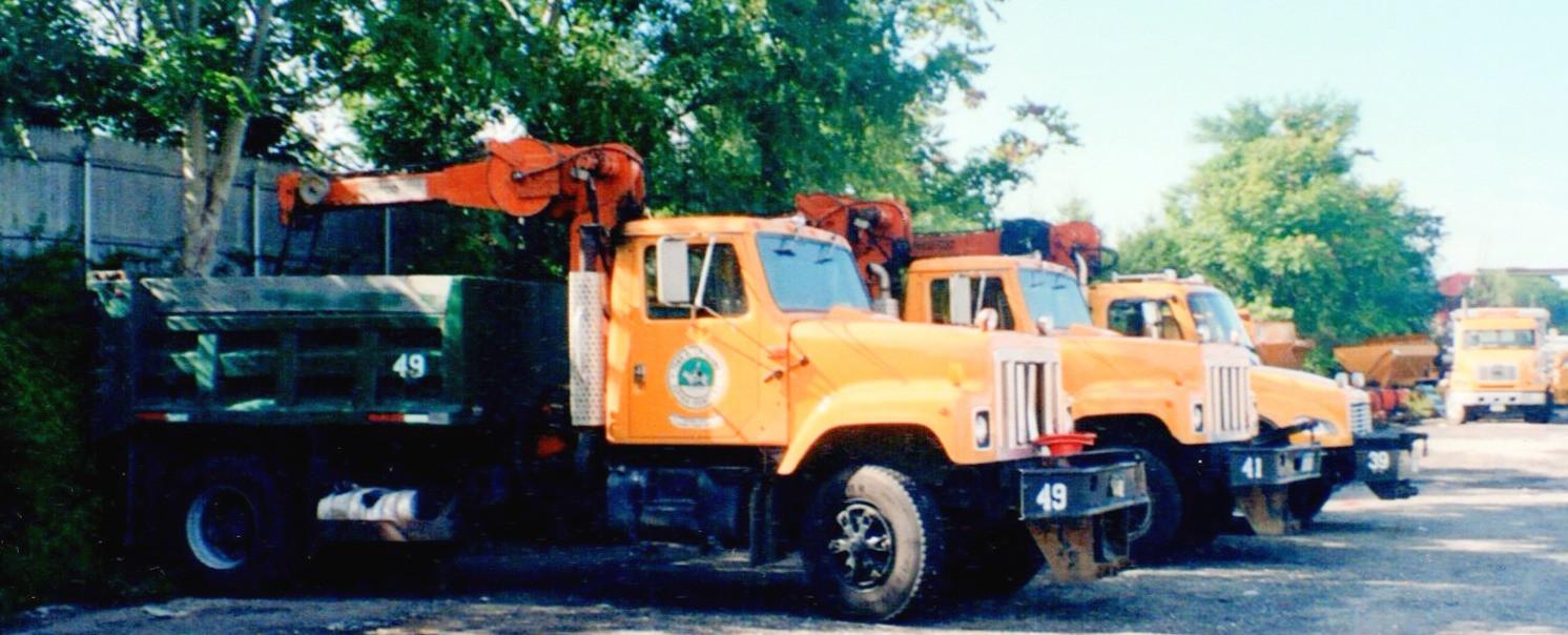 Two 2001 International 2554 basin trucks and a 2005 Frightliner SL80 basin truck.