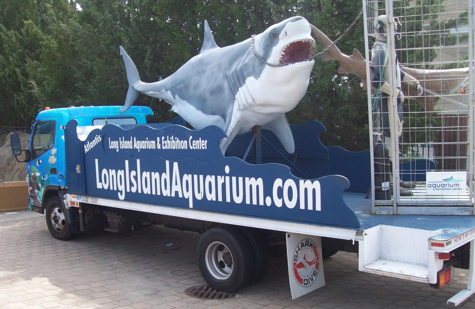 Truck with fiberglass great white shark