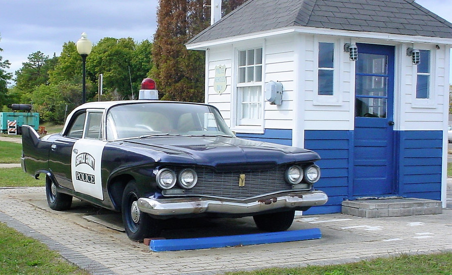 1960 Plymouth and an old police booth