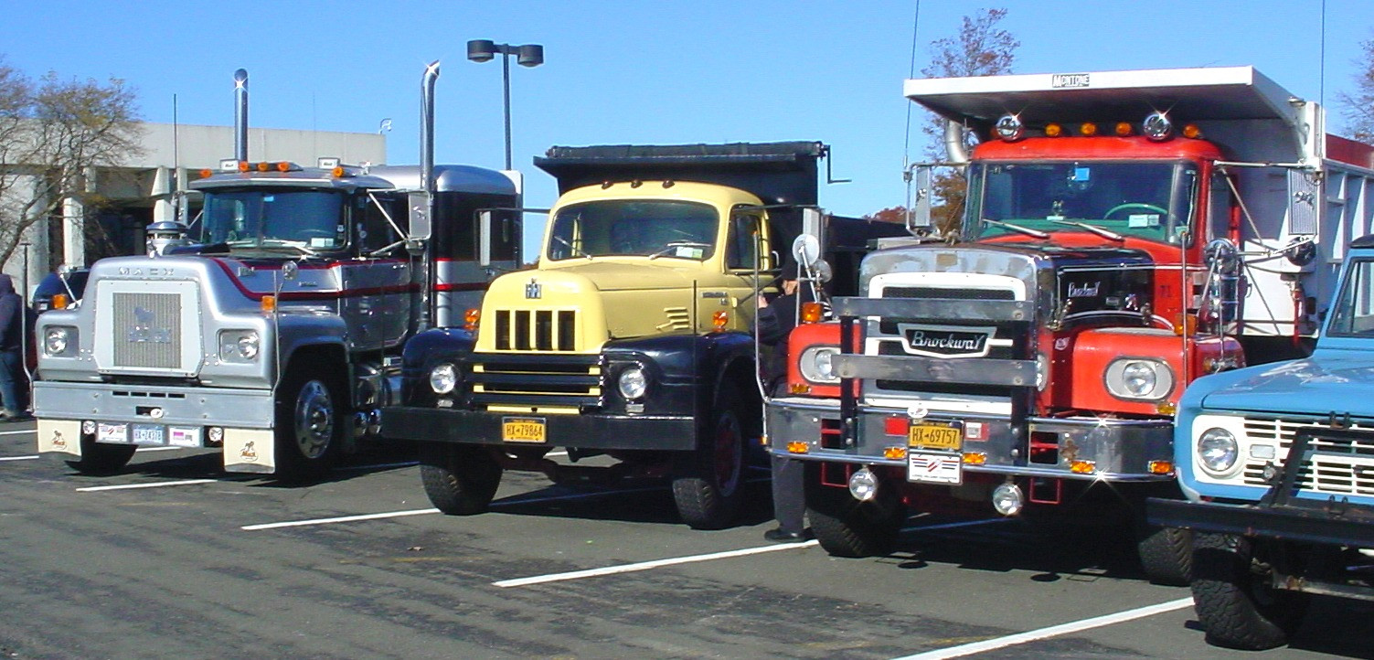 Howard Pratt's 1976 Mack tractor, Craig Kenda's 1962 International dump, Howard Pratt's 1971 Brockway dump, & Ron Bruschi's 1966 Ford Bronco