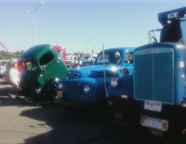 George Erb's 1961 White dump, Craig Kenda's 1948 Ford flatbed, & Floyd Chivvis' 1947 Ford COE wrecker