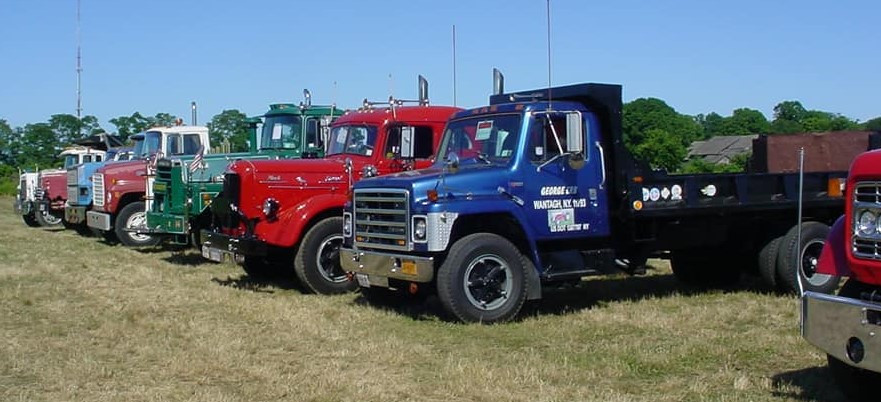 Line up of trucks on show field