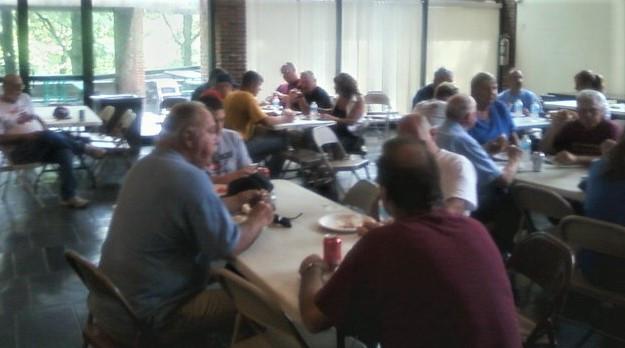Members having lunch at Old Bethpage Village