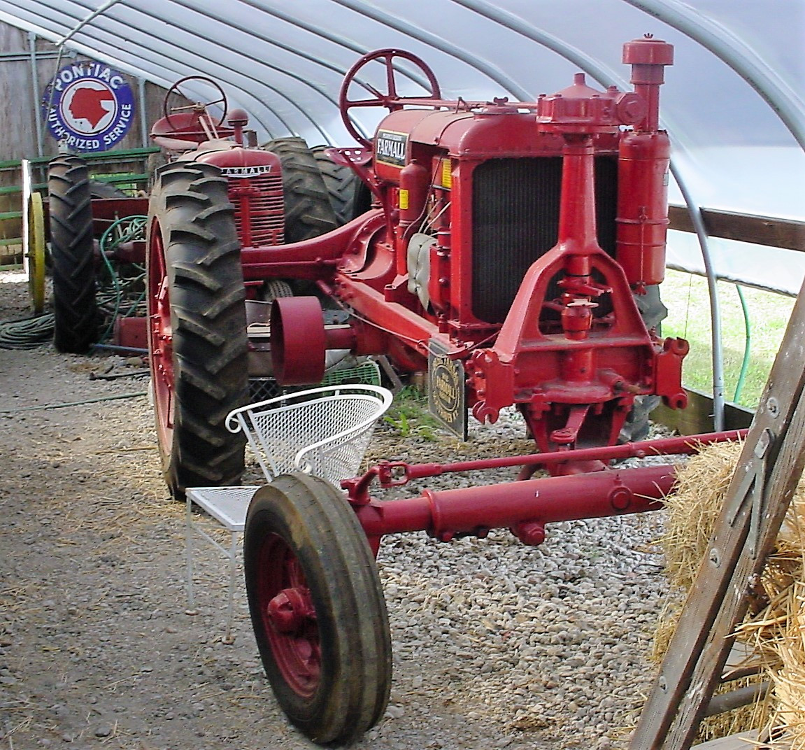 Two of Ron Bush's Farmall tractors
