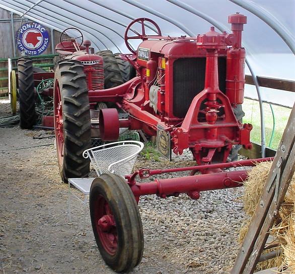 Two of Ron Bush's Farmall tractors