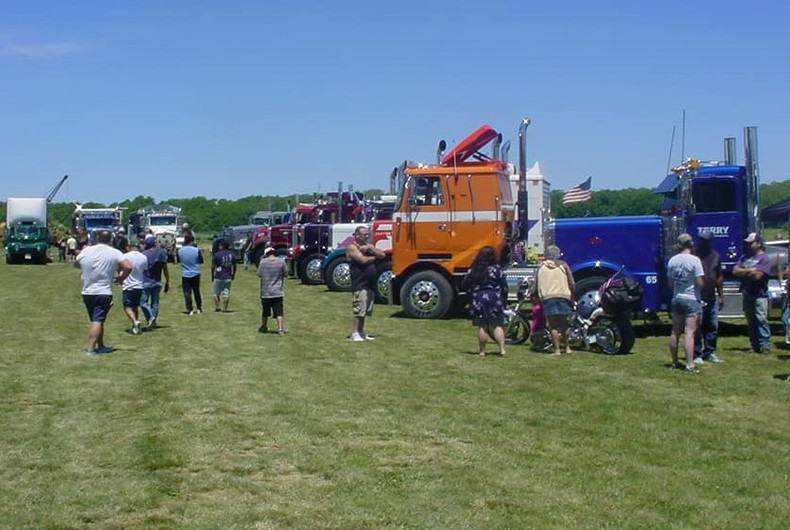 Spectators viewing trucks on display