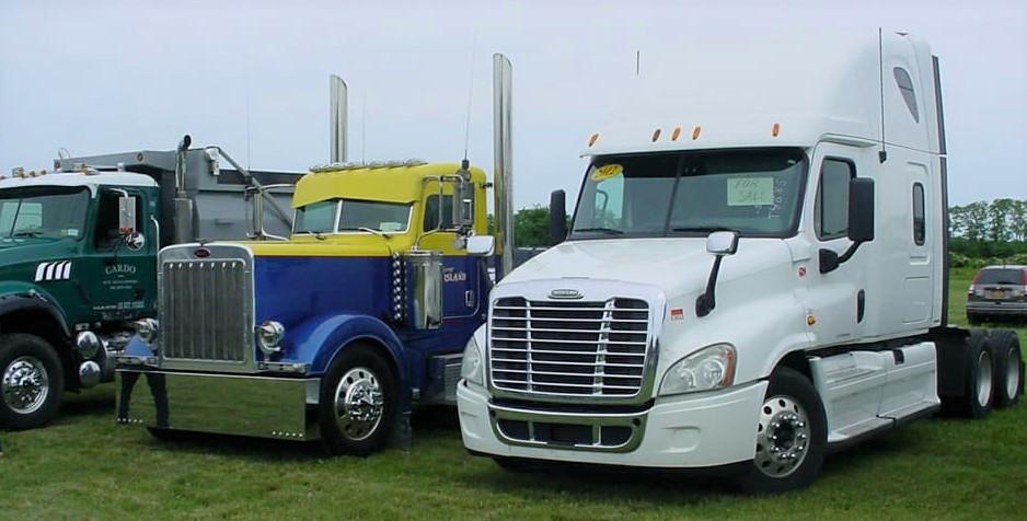 Lineup of big rig tractors & a dump