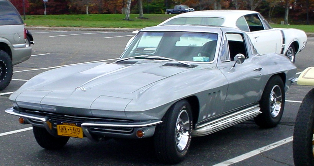 Corvette & an Olds 442 on display