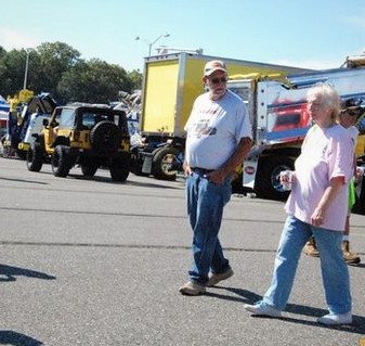 Butch Pratt & Lynne Fiebe viewing the trucks at the show