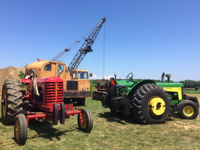 Old farm tractors and crane on display