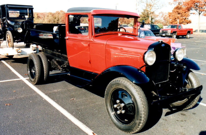 1931 Ford dump towing a Model T