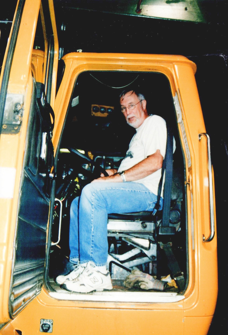 Bob Fraser sitting in Denis' 1992 Autocar dump.