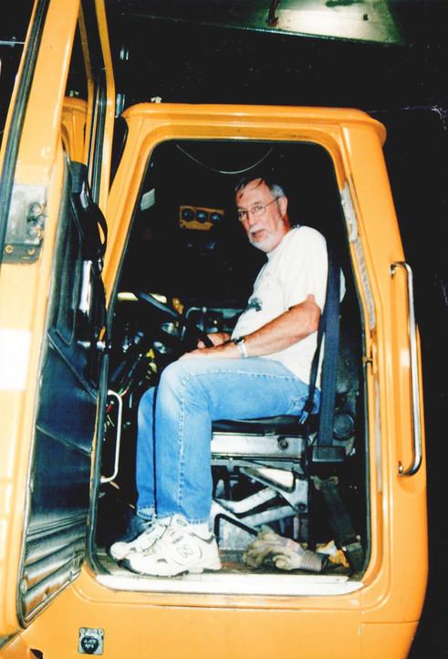 Bob Fraser sitting in Denis' 1992 Autocar dump.