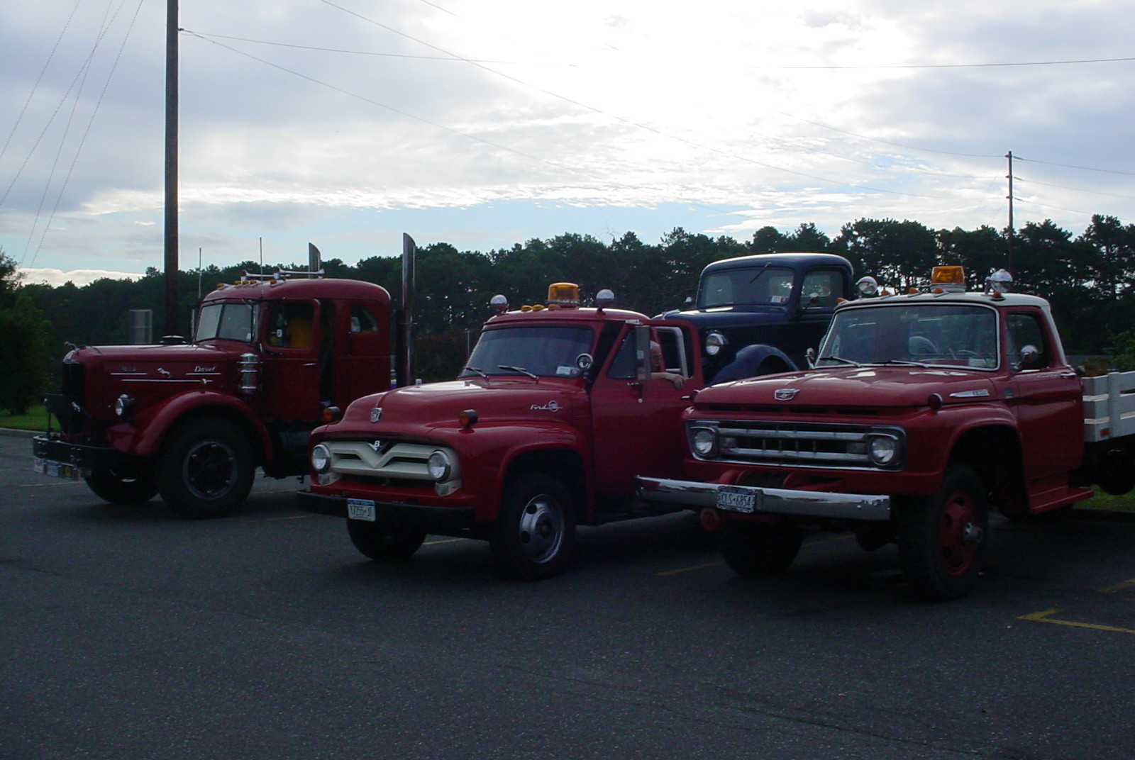 Member's trucks lined up at the start of the run in Bohemia