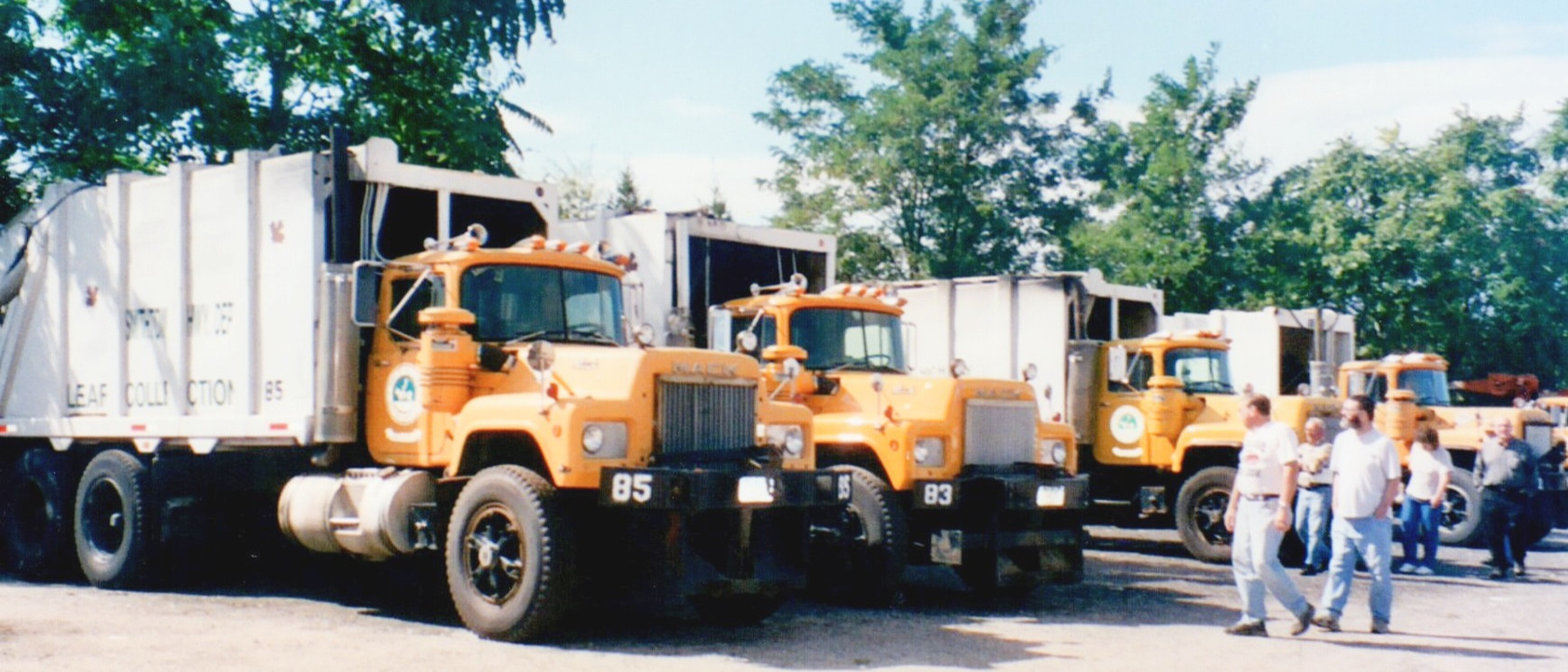 Older Macks with packer bodies for picking up leaf bags and brush. 85 truck (1988 Mack) assigned to Denis at one time.