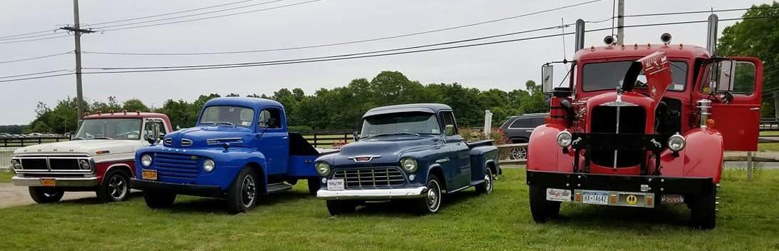 Line up of Members antique trucks