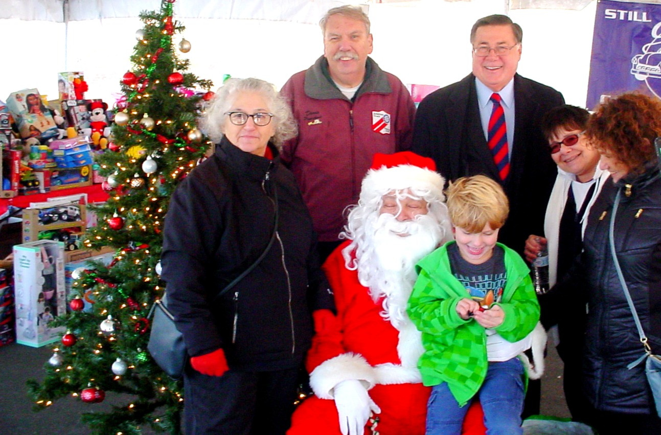 Chapter President Denis with Brookhaven Town Supervisor Ed Romaine, other sponsorings club officers, Santa and a friend