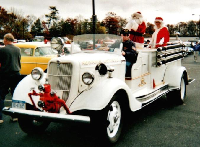 Floyd Chivvis bringing in Santa & Mrs. Claus