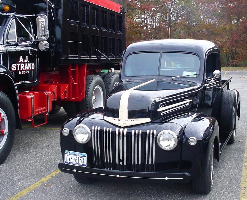 1946-47 Ford pickup next to A.J. Strano's 1961 Mack dump