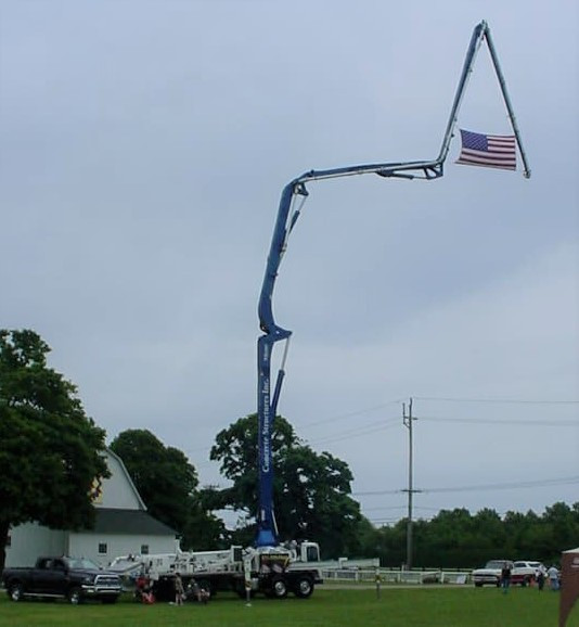 Concrete pumping truck with flag