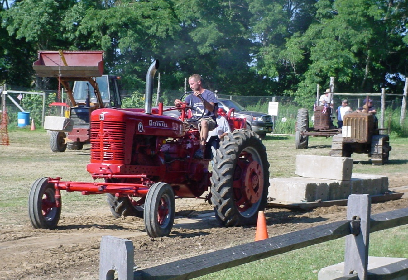Farmall M tractor on the pulling track