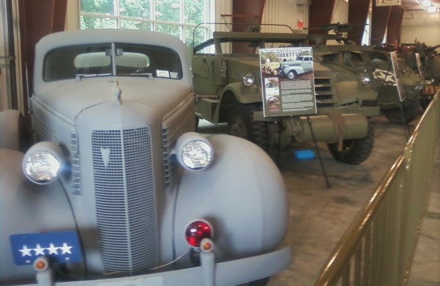 Staff car & armored vehicles inside military museum