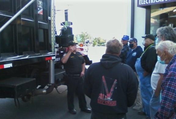 NY State Police Officer John Devoe performing a DOT truck inspection demonstration on Garrett Lake's 2000 Mack 10 wheeler dump