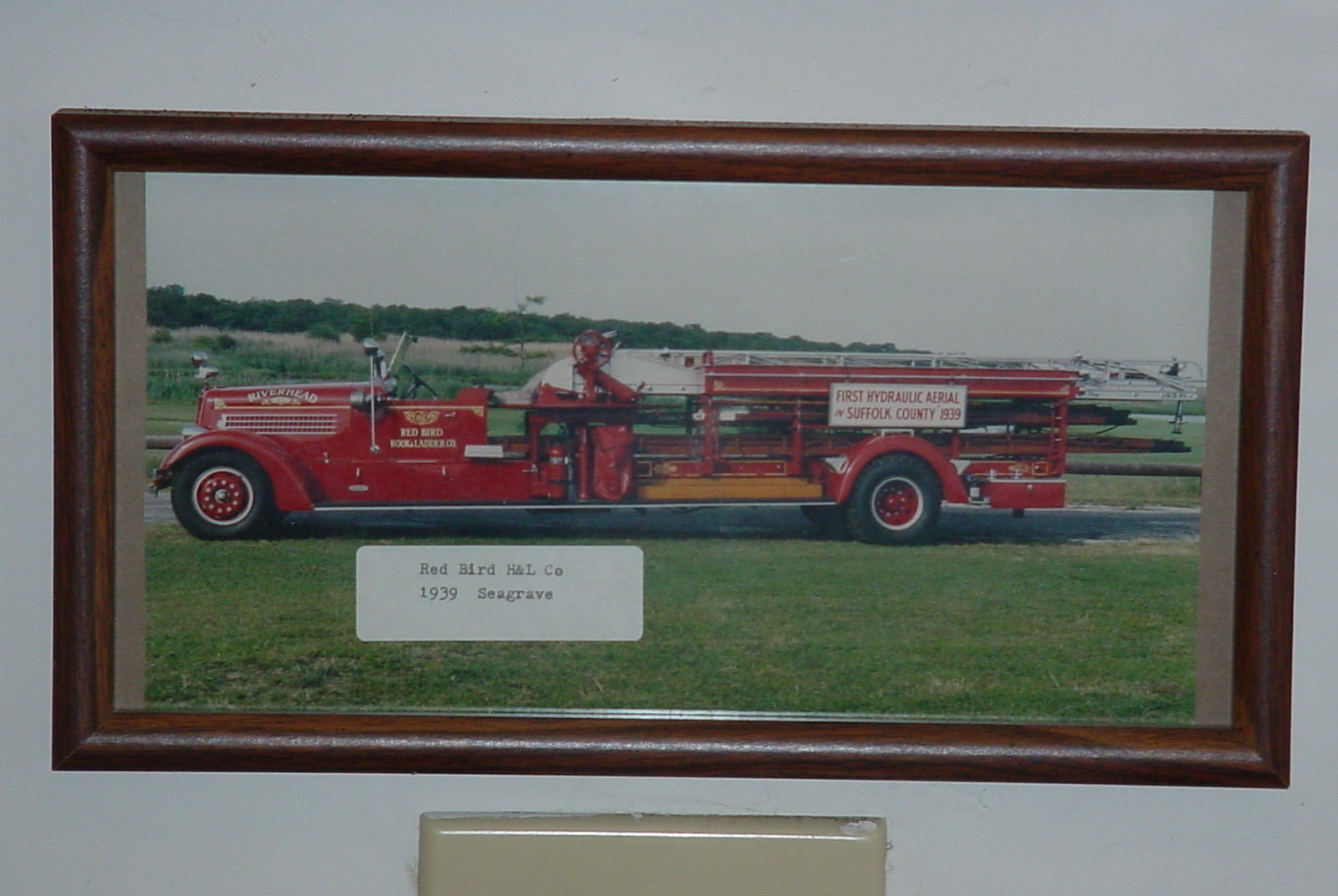 Photo of Riverhead F.D's 1939 Seagrave aerial