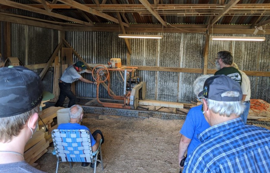 Members & guests viewing the Norwood band-saw mill in action