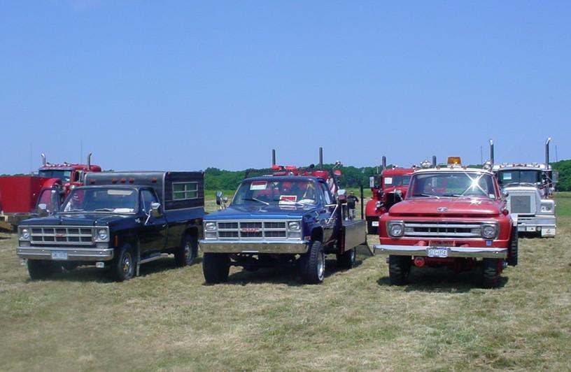 Earl Scott's 1978 GMC Sierra pickup, George Erb's 1983 GMC Sierra flatbed, & Craig Kenda's 1966 Ford F-600 flatbed